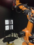 Some kind of assembly robot working on iSlate
